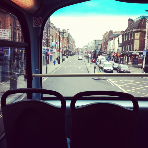 A photo showing the first row of the upper deck of a double decker bus in London